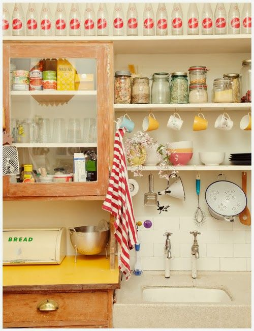 A cheery kitchen showcases a great collection of vintage wares.