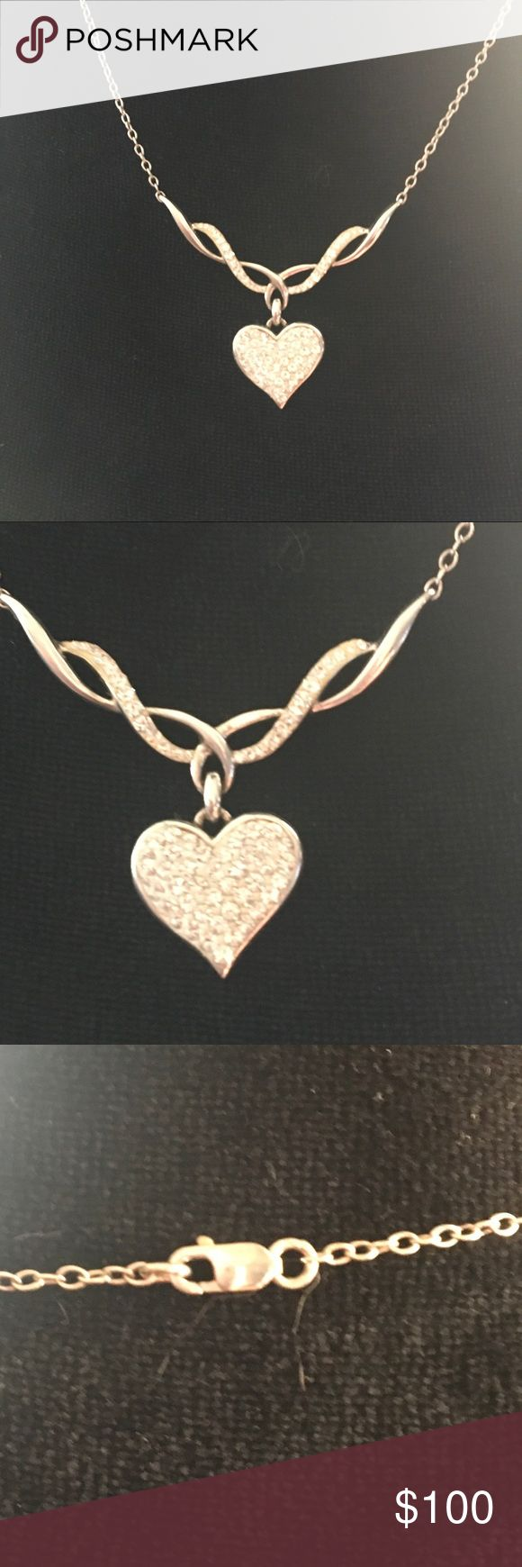 Gorgeous silver and CZ heart necklace Gorgeous silver and CZ heart necklace.  Marked .925 AU.  Lobster clasp.  So super glittery in the sunlight.  Pictures do not do this justice.  Paid over $120. Super deal! #diamonds#simulated#wedding#goldlike#shiny#glamor#glamour#present#gift#hearts#beautiful#betsey#suncatcher Vintage Jewelry Necklaces