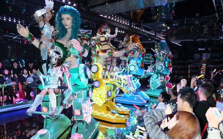 A raunchy robot restaurant has opened in Tokyo, Japan. The strange eatery, which is in the city's Shinjuku Kabukicho District, is patrolled by giant 'fembots'. These statuesque female robots are controlled by real-life, scantily-clad women.Picture: Masatoshi Okauchi / Rex Features