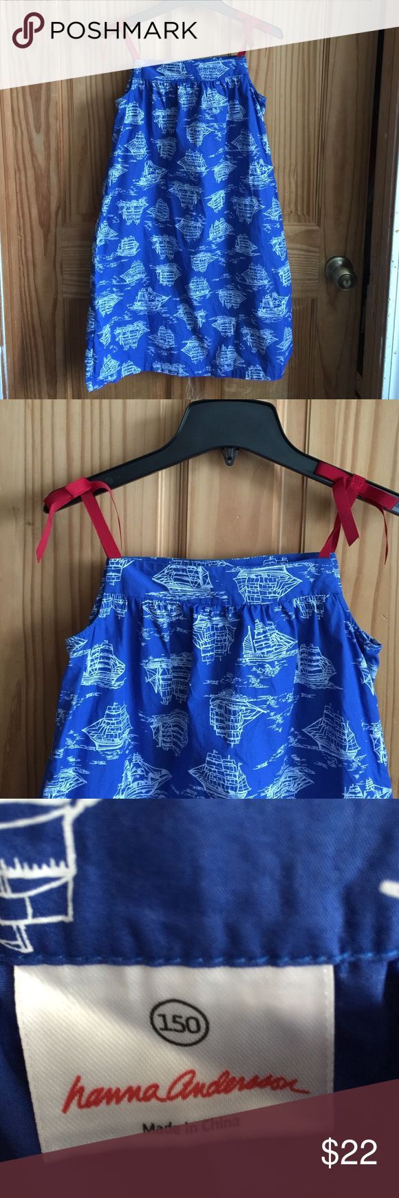 Girls Hanna Anderson 150 nautical dress  Girls Hanna Anderson 150 nautical dress  , in new condition. Took tags off but my daughter never wore it.  Beautiful dress with grosgrain ribbon  ties for straps in red to offset the beautiful blue and white nautical pattern.  Pair w red leggings or blue.. this would be charming. Dog friendly home. Smoke free. Hanna Andersson Dresses Casual
