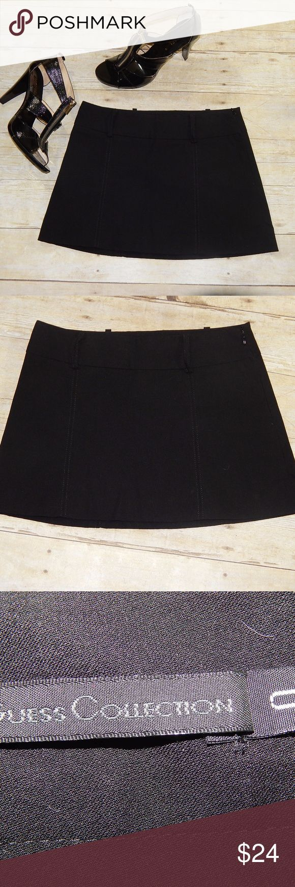 Guess Collection Black Mini Skirt Size 0 Guess Collection Mini Skirt Size 0  Black Has belt loops for any belt you would like to style with it 74% rayon, 22% nylon, 4% spandex Measurements Length 12 Waist laid flat 13.75 Worn once All items are from a non-smoking home Any questions, please ask Bundles and offers welcome Guess Skirts Mini