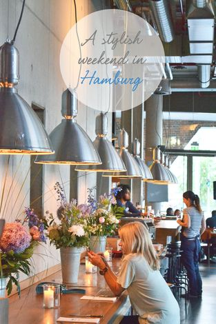 Hamburg coffee shop = just love this layout, with big lamps and huge vases of fresh flowers