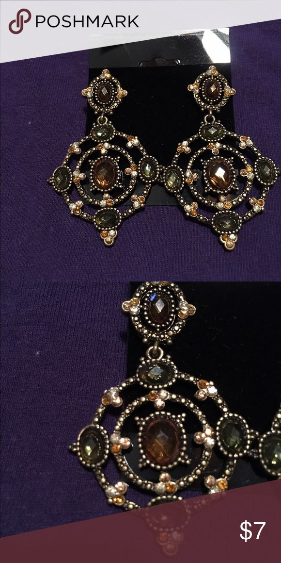 """Earrings This is a lovely pair of Avon earrings that have only been worn maybe one time.  They are black and gold with olive and brown rhinestone accents.  These earrings measure 2 1/2"""" in length.  They are in great condition. Avon Jewelry Earrings"""