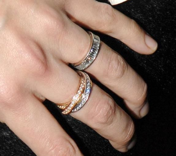 Katie Holmes' former wedding bands. Baguette and Cartier Trinity rolling ring.