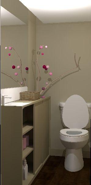 une branche d'arbre amène la nature dans cette décoration de toilettes zen