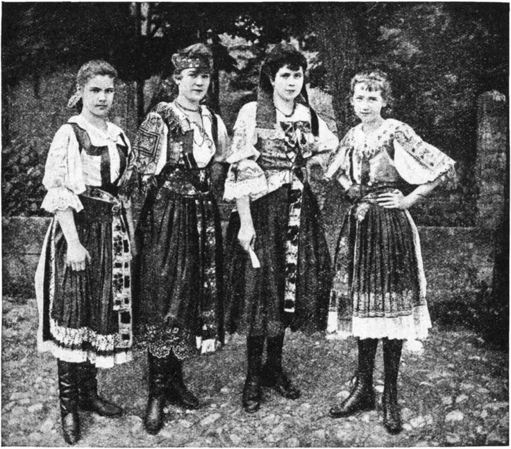 Slovakia is said to be a museum of folk art, and the costumes of this charming quartette from Turciansky Sv. Martin, adequately represent those wonderful products of Slovak needles, which can be ranked with some of the finest peasant handiwork in the world. But modern commerce is beginning to play havoc with the peasants' art, and the lovely costumes of Czechoslovakia are donned more frequently as festal than as everyday dress