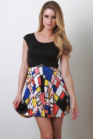 Block primary  colour has been used to fill the irregular sized shapes. The skirt contrasts the black shirt.
