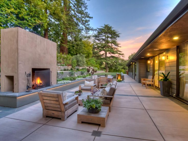 Backyard Architect Part - 43: Using Terraces With Plants, Flowers And Trees Can Help Soften Architectural  Features Such As This