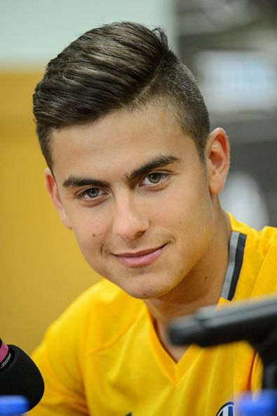 Juventus football player Paulo Dybala smiles during a press conference in Hong Kong on July 29 2016 / AFP / Anthony WALLACE