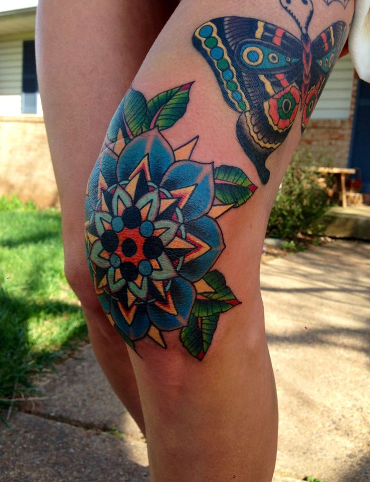 Traditional  flower and butterfly tattoo.