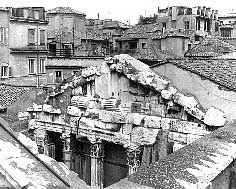 Remains of the pediment of the Portico d'Ottavia, photographed about 1880