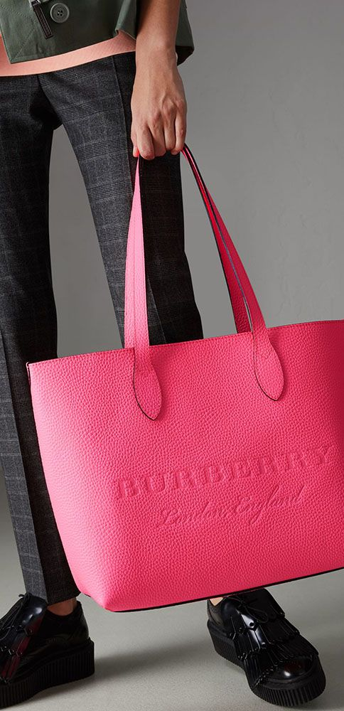 382f70d82ce A versatile tote by  Burberry in Italian-tanned calf leather in a vibrant  neon tone, with an interior zip pocket for small essentials. The minimalist  design ...