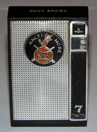 """Vintage Electra Pee-Wee 7 Transistor Radio with Baltimore Orioles Logo (Doug Brown), Model Number MTR-716.  This is a very small radio measuring approximately 1-3/4"""" W x 2-5/8"""" H."""