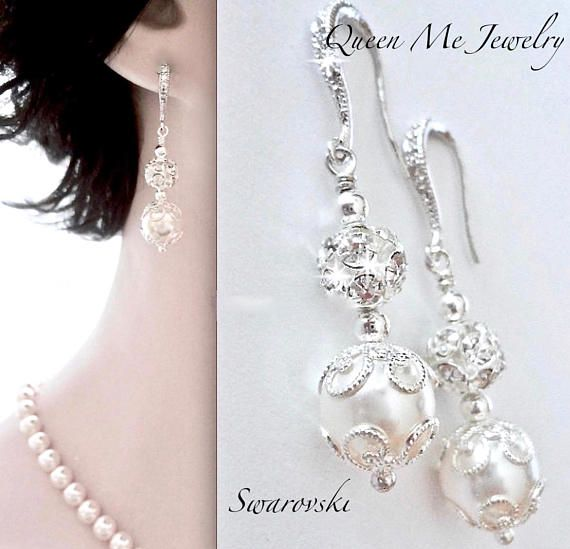 Bridal jewelry ~ Pearl earrings ~ Brides earrings ~ Wedding jewelry ~ Swarovski pearl earrings ~ These pearl drop earrings are amazingly detailed with a lacey filigree design. They are super feminine and have a Victorian feel. They offer sterling silver ear wires that have sparkling