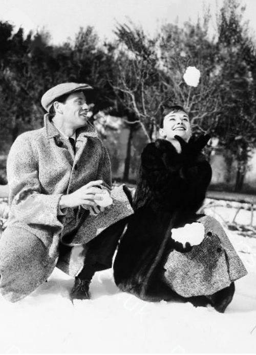 Audrey Hepburn with husband enjoying the fresh snow on the grounds of King Vidors villa in Rome, Italy on February 24, 1956.