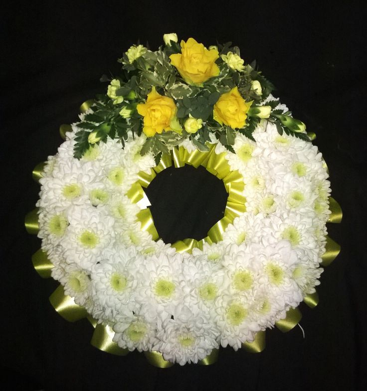 white based wreath with yellow roses