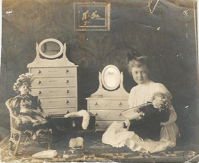 girl in nursery wih two dolls and dresser by Lauren Jaeger Mikalov, via Flickr