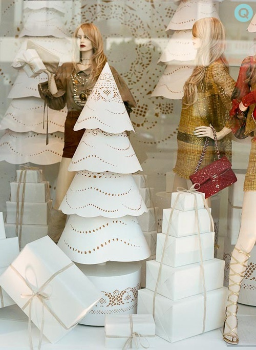 Love the simplicity of these paper doilie trees in this Chanel holiday window display. #retail #merchandising #Christmas #window_display #paper #trees