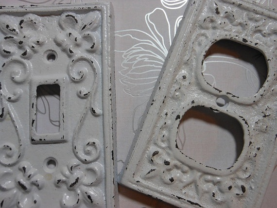 Shabby white light switch and outlet plates.