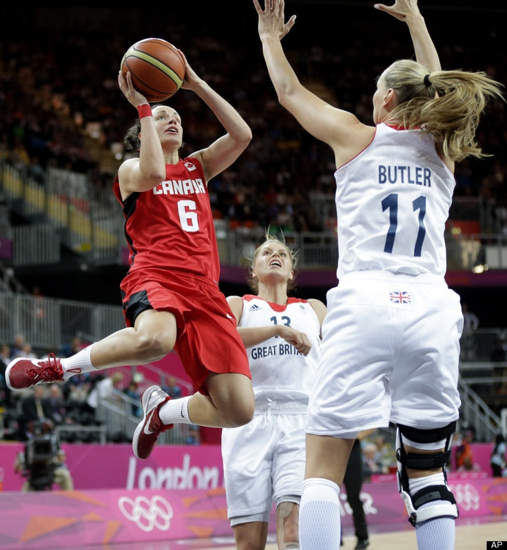 Canada's Shona Thorburn (6) shoots as Great Britain's Kim Butler (11) and Johannah Leedham (13) defend during the first half of a preliminary women's basketball game at the 2012 Summer Olympics, Monday, July 30, 2012, in London.