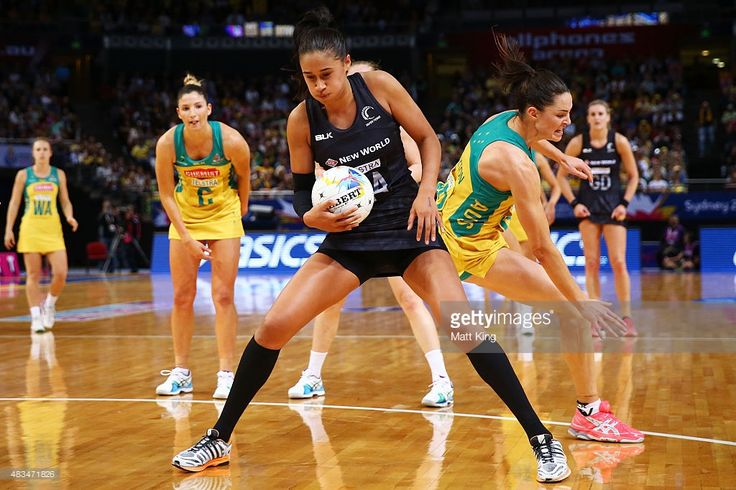 Maria Tutaia of New Zealand is challenged by Sharni Layton of the Diamonds during the 2015 Netball World Cup match between Australia and New Zealand at Allphones Arena on August 9, 2015 in Sydney, Australia.
