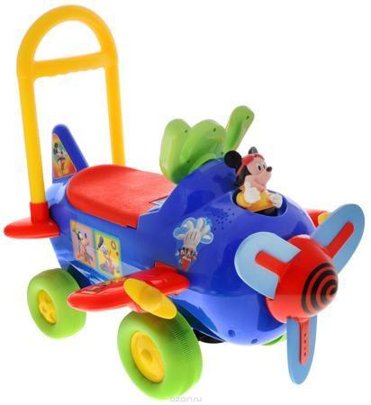 """Kiddieland Каталка Самолет Микки Маус цвет синий  — 5854р. ----- Каталка Kiddieland """"Самолет Микки Маус"""" станет замечательным транспортным средством для ребенка от 1 года. Игрушка выполнена в виде самолета и дополнена фигуркой Микки Мауса. Изготовлена каталка из прочного яркого материала. На капоте - пропеллер, который умеет быстро крутиться. Он изготовлен из мягкого полимерного материала. Руль этой каталки выполнен в форме штурвала самолета. По бокам имеются крылья с маленькими пропеллерами…"""
