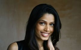 Download Freida Pinto Smile Wide HD Wallpapers From High Quality Resolution