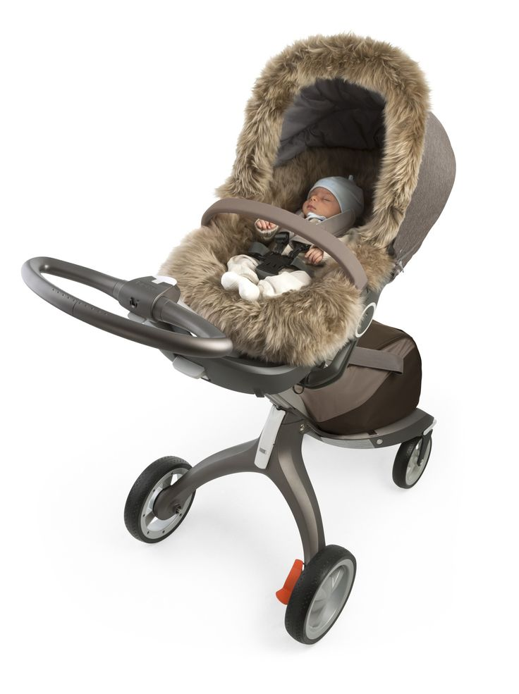 The Stokke® Xplory® Winter Kit is the perfect stroller accessory to protect your child this winter. Pictured with our Sheepskin stroller liner