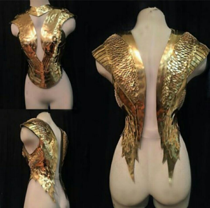 Stunning gold decorative body armor. This looks like a piece from a museum but n…