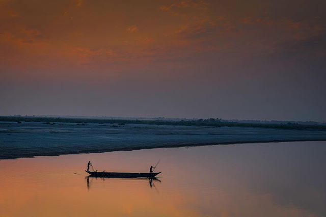 Sunset on the mighty river Brahmaputra ought to be a quiet and easy time but I guess photographers can't stand a little quite and Im among them. . Camera SONY Alpha 7 Series Lens Zeiss  FE 24-70mm f/4 ZA OSS . NiSiV5 PROHolder NiSi GND and CPL Filters . #skyporn #sunrise #sunsetlovers #cloudporn #sunsets #sunsetporn #sunset_madness #skylovers #sunset_pics #ocean #skyline #evening #dusk #horizon #sunset_hub #water #river #bridge #boat #riverside #река #fisherman #orange #colourful #colours…