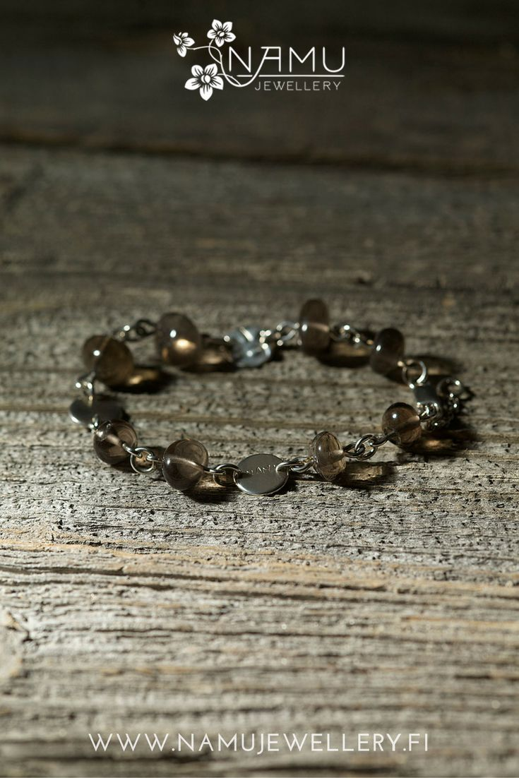 Silo One bracelet. Made of handcrafted, recycled silver and ethically sourced smokey quartz from Uhlu, Finland. The stones in Silo are tumbled to remind pebbles at a beach.