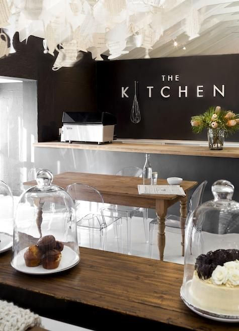 The Kitchen Restaurant - South Africa- Light floors, chocolate walls and simple metal skin on counters