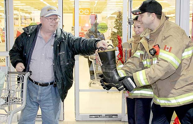 Firefighters and volunteers collected donations at the Real Canadian Superstore in Pitt Meadows on Saturday as part of Firefighters for Families. It's an annual one-day fundraising drive that collects for two local charities.