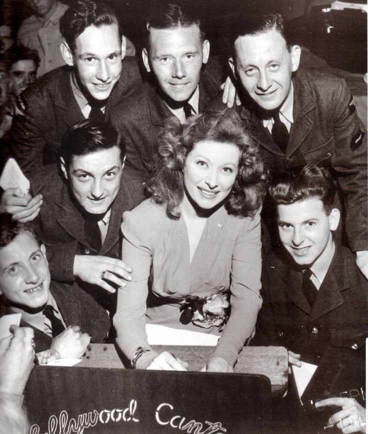 Greer Garson signing autographs for WWII soldiers at the Hollywood Canteen.