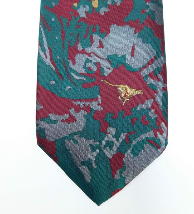 Hunter International corporate tie with a floral pattern and a cheetah emblem There is no maker s label or garment composition label on this tie I am