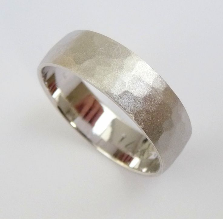 A personal favorite from my Etsy shop https://www.etsy.com/listing/128902738/wedding-band-white-gold-mens-wedding