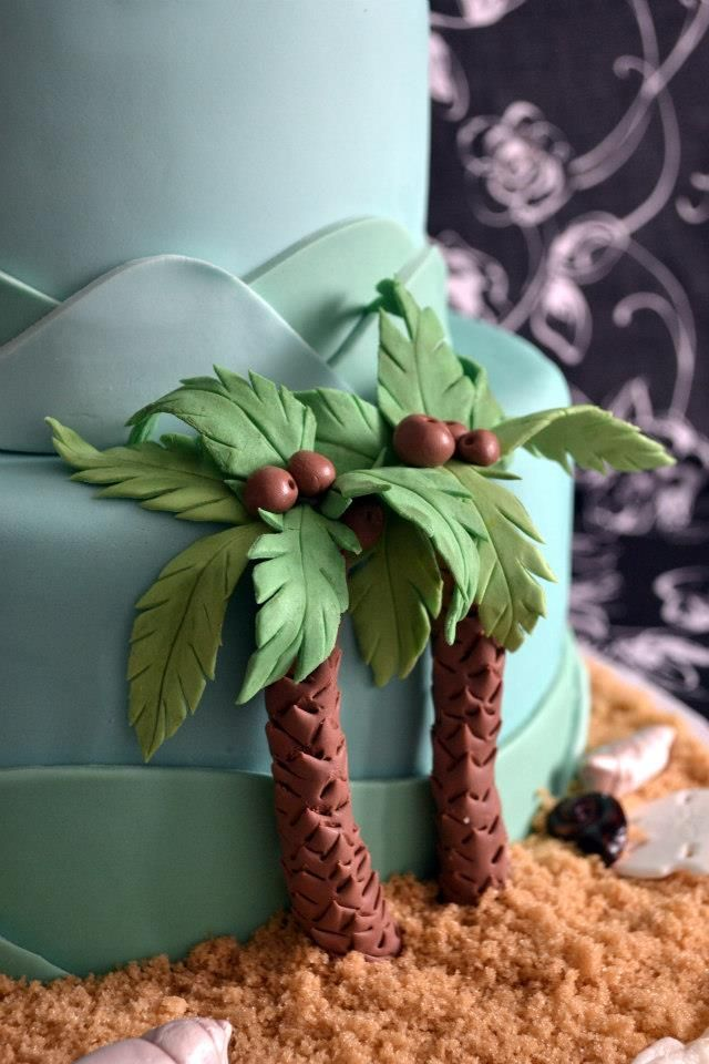 A pair of gumpaste palm trees on a beach theme wedding cake. More at www.cucinadolce.ca