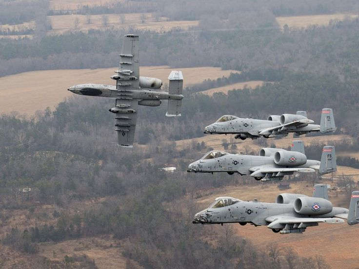 """A-10Cs from what was then the 188th Fighter Wing of the Arkansas Air National Guard fly formation maneuvers over Fort Smith in 2013. The A-10 is slowly disappearing. The 188th divested itself of its last Warthogs (and its """"Fighter"""" designation) in June 2014. (USAF/Senior Airman Matthew Bruch)"""