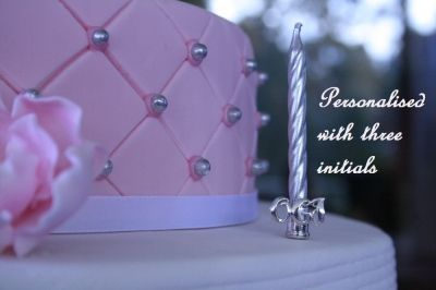 A sterling silver monogrammed birthday candle holder