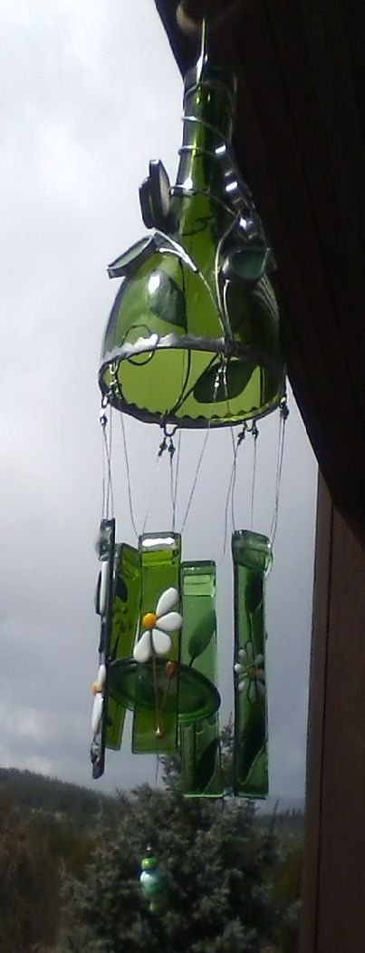 The wine bottle wind chime I was given for Christmas. It was made by a lady named Tracy up at Priest Lake! I love the daisies on it. :-)