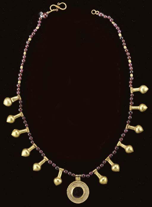 A ROMAN GOLD AND GARNET BEAD NECKLACE   Circa 2nd-3rd Century A.D.
