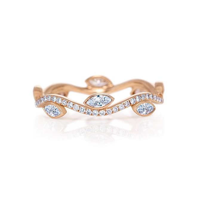 """Brides.com: De Beers Wedding Jewelry for the Modern, Classic and Romantic Bride. Romantic Wedding Band. """"The organic shapes in this beauty have such a delicate, lyrical quality about them. It's perfect for the bohemian bride."""" —100 Layer Cake  Style J1FW02Z00K, Adonis Rose Band, $3,700, De Beers  Browse De Beers engagement rings."""
