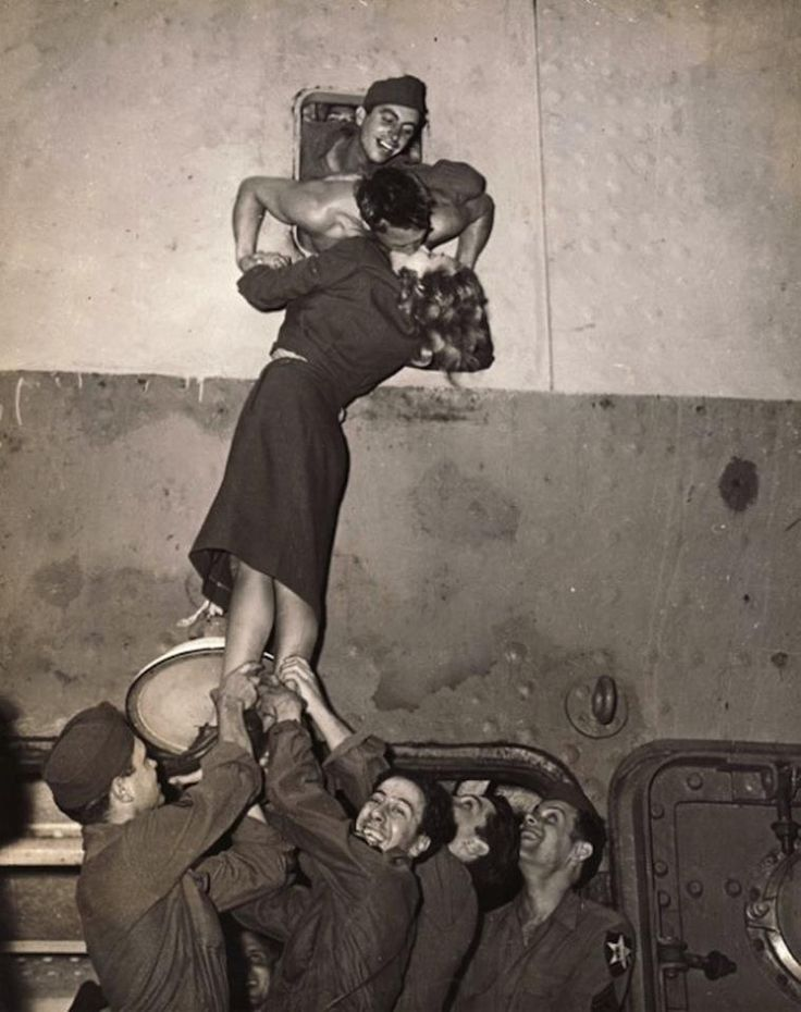 Marlene Dietrich passionately kissing a soldier as he arrives home from World War II, New York, 1945. Photo by Irving Haberman