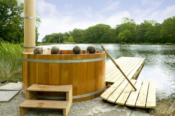 Some locations have wood-fired hot tubs overlooking swimming ponds.