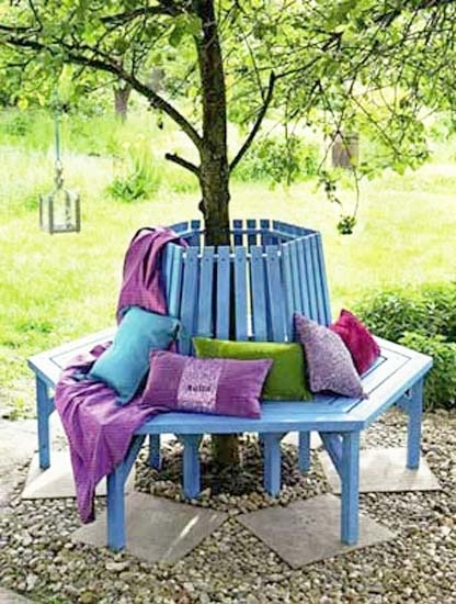 A beautiful bench built around a wonderful shade tree.