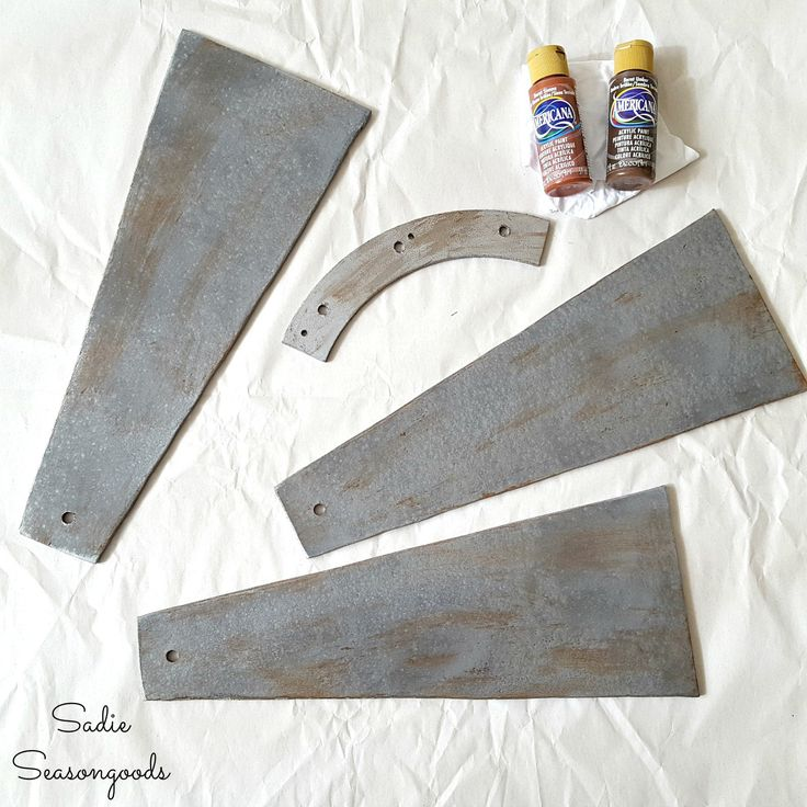 Outdated ceiling fan blades to be repurposed into DIY farmhouse style salvaged windmill decor by Sadie Seasongoods / www.sadieseasongoods.com