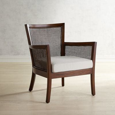 Just imagine our traditional chair surrounded by tropical greenery that sets off its dark finish. This is the chair to sip a large fruity drink from in the summer and then add a blanket and a glass of wine for when the weather turns cooler. Rhea is crafted of mahogany wood and natural rattan and is ready for all the relaxation you can handle. Cushion sold separately.