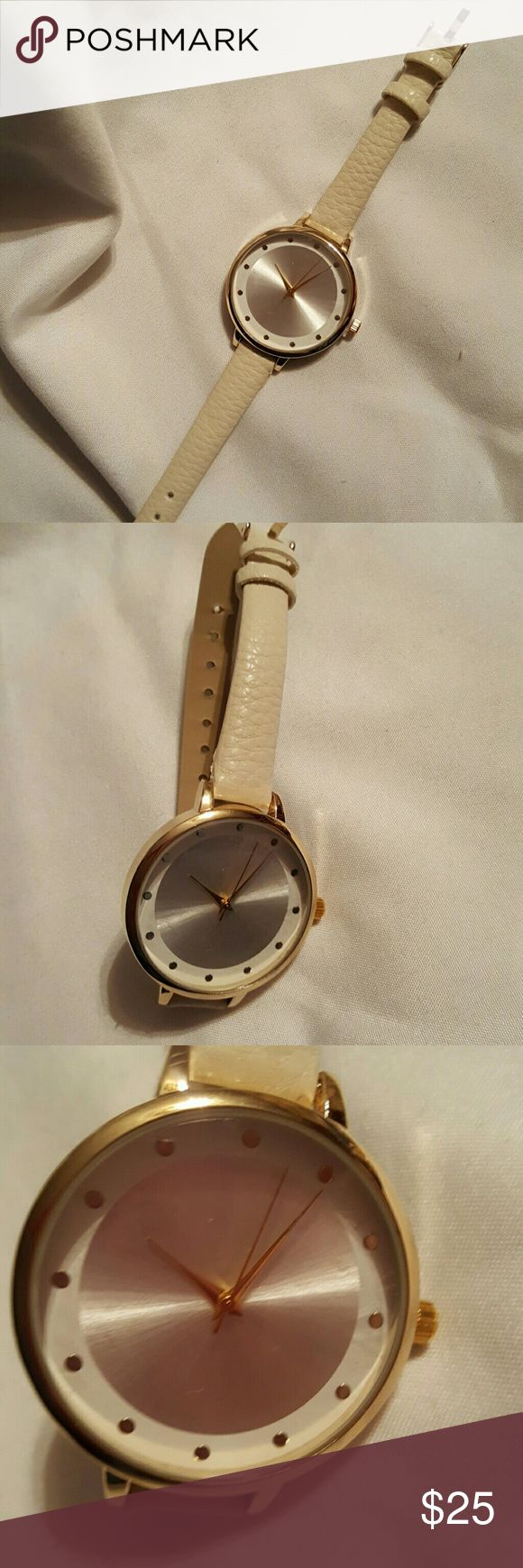 NwT Ladies Big Face Watch Genuine leather strap in ivory and gold tone latch. Gorgeous daylife and nightlife watch. Large face for easy reading. Accessories Watches