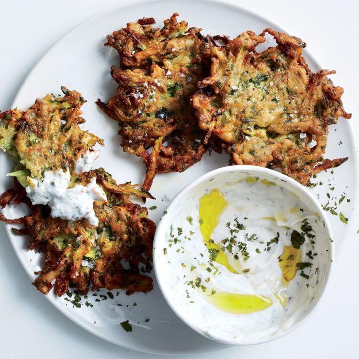 Squeezing the liquid out of the zucchini is the secret to crisp fritters. (The potato helps, too.)