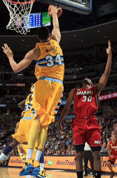 JaVale McGee #34 of the Denver Nuggets blocks a shot by Norris Cole #30 of the Miami Heat at the Pepsi Center on November 15, 2012 in Denver, Colorado.